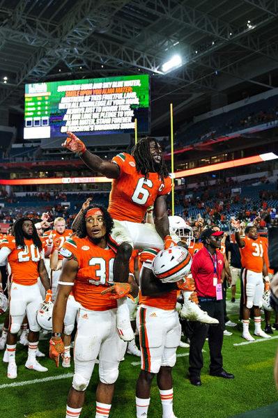 Senior, Jamal Carter, is hoisted by his teammates