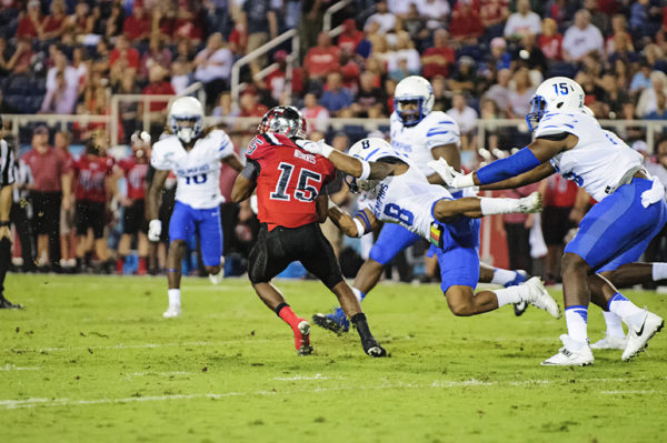Western Kentucky WR, Nicholas Norris, tries to escape from the clutches of a Memphis defender