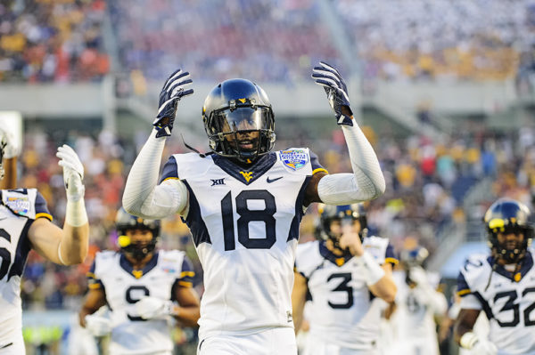 Marvin Gross Jr, West Virginia S, pumps up the fans in the endzone