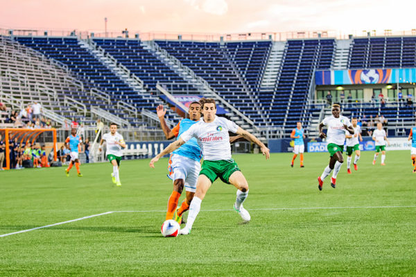 A battle for the ball between Miami FC and the New York Cosmos