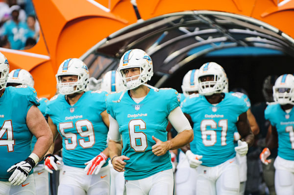 Dolphins QB #6, Jay Cutler runs through the tunnel