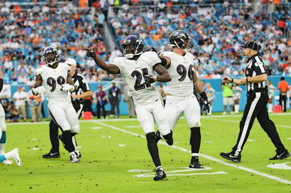Ravens CB #21, Ladarius Webb, celebrates his sack