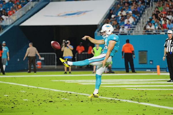 Matt Haack, Dolphins #16, punts the ball