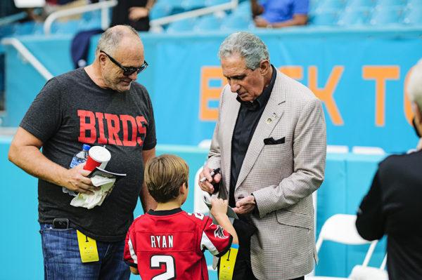 Atlanta Falcons owner, Arthur Blank, signs autographs for fans