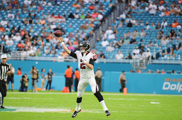Falcons QB, Matt Ryan, attempts a pass while running out of the pocket