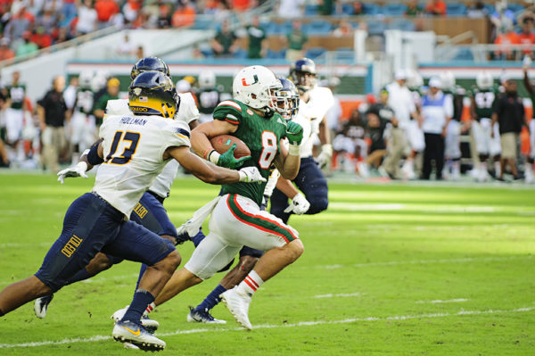 Braxton Berrios runs after a catch