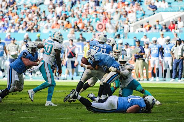 Charles Harris swings Matt Cassel around for the sack