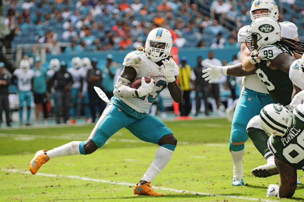 Jay Ajayi begins a spin move to evade the defense