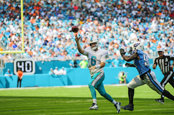 Dolphins QB, Jay Cutler, throws the pass out of bounds to avoid a sack