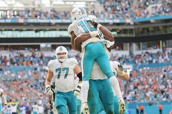 Kenny Stills (10) celebrates his touchdown