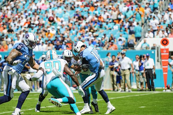 Cameron Wake hits Titans QB, Matt Cassel, as he throws a pass