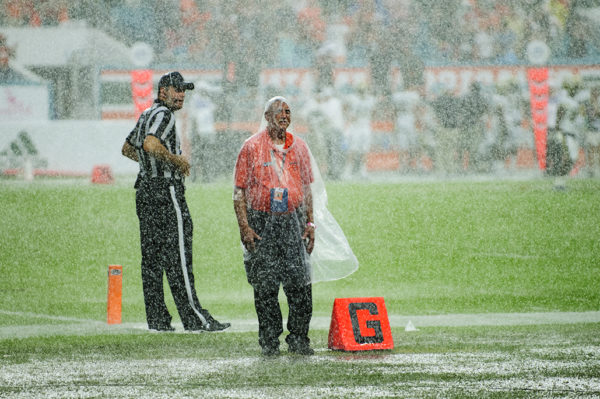 Security working in the rain delay