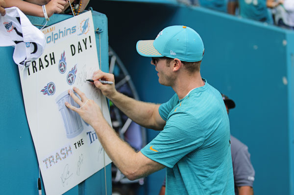 Injured Dolphins QB, Ryan Tannehill, signs autographs for fans