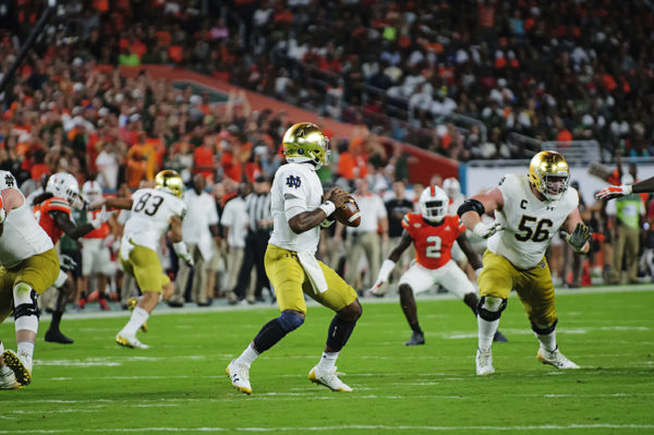 Brandon Wimbush (7) looks downfield for a pass