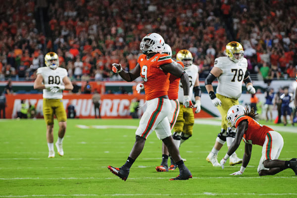 Chad Thomas (9) celebrates a tackle