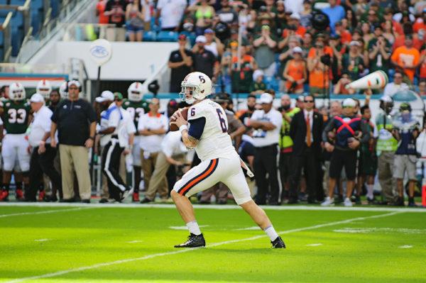Kurt Benkert (6) looks to throw a pass