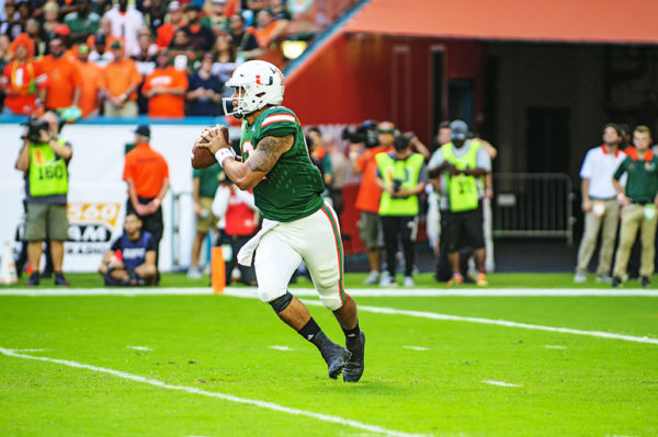 Malik Rosier (12) scrambles to his left while he looks for a receiver