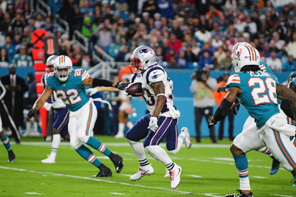 Dion Lewis (33) tries to find room to run