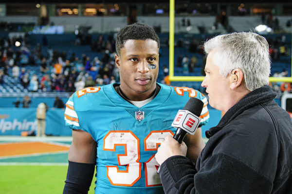 Kenyan Drake gives an interview after the victory