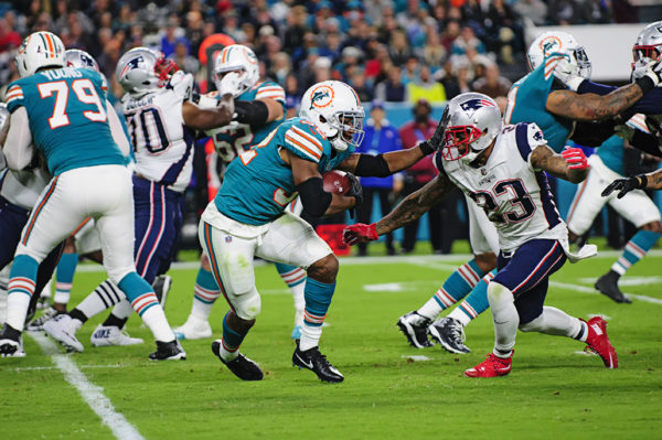Kenyan Drake extends a stiff arm
