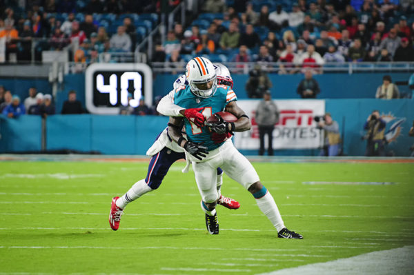 Malcolm Butler tackles Jarvis Landry (14) from behind