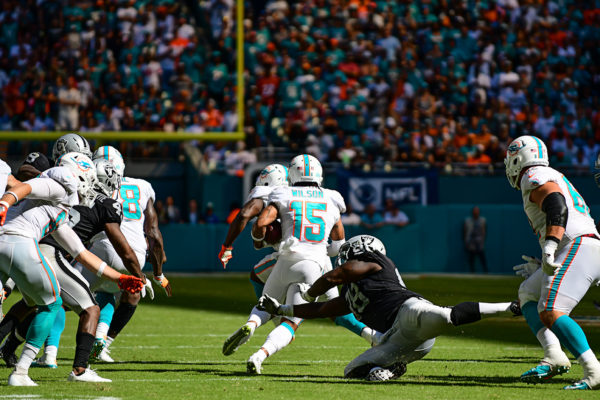 Miami Dolphins wide receiver Albert Wilson (15) finds a hole that springs him towards a touchdown