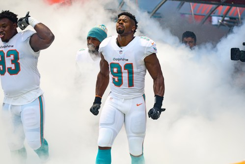 Miami Dolphins defensive line comes out through the smoke together