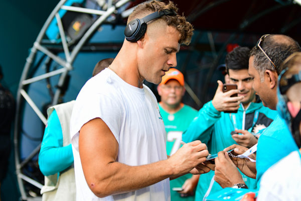Miami Dolphins linebacker Kiko Alonso (47) signs autographs for the fans