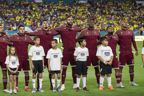 Venezuela players sing their national anthem