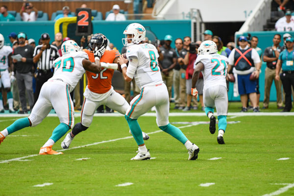 Miami Dolphins quarterback Brock Osweiler (8) stands in the pocket