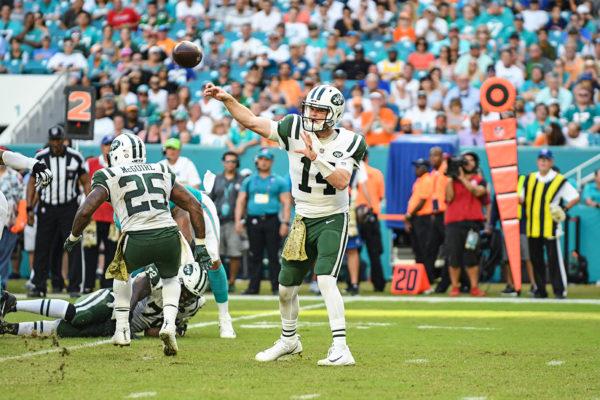 New York Jets quarterback Sam Darnold (14) throws a pass