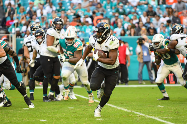 Jacksonville Jaguars running back Leonard Fournette (27) finds some room to run
