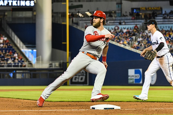 Philadelphia Phillies right fielder Bryce Harper (3) looks at the outfielder while rounding third base