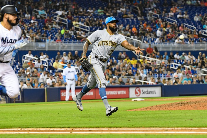 Pittsburgh Pirates relief pitcher Felipe Vazquez #73 tosses the ball to first - Pittsburgh Pirates vs. Miami Marlins at Marlins Park
