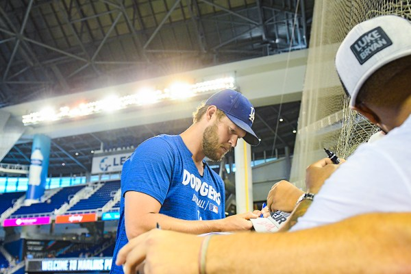 Los Angeles Dodgers starting pitcher Clayton Kershaw signs autographs