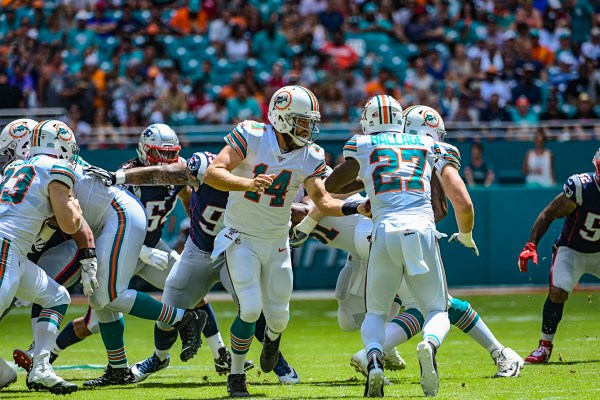 Miami Dolphins quarterback Ryan Fitzpatrick #14 hands off to Miami Dolphins running back Kalen Ballage #27 | New England Patriots vs. Miami Dolphins | September 15, 2019 | Hard Rock Stadium