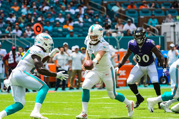 Miami Dolphins quarterback Ryan Fitzpatrick (14) hands the ball off to Miami Dolphins running back Kalen Ballage (27) | Baltimore Ravens vs. Miami Dolphins | September 8, 2019 | Hard Rock Stadium