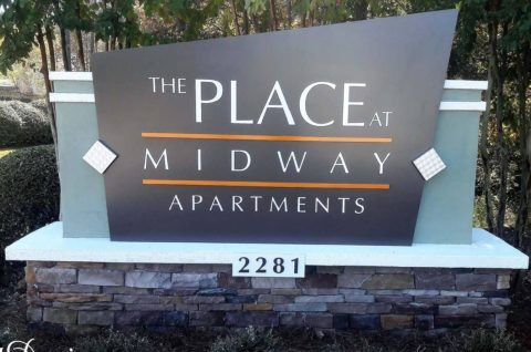 The place at midway apartment ID sign