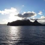 Sunlight backlights a Hawaiian island