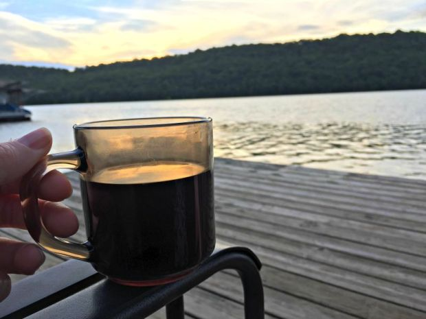 Surise with coffee on the dock