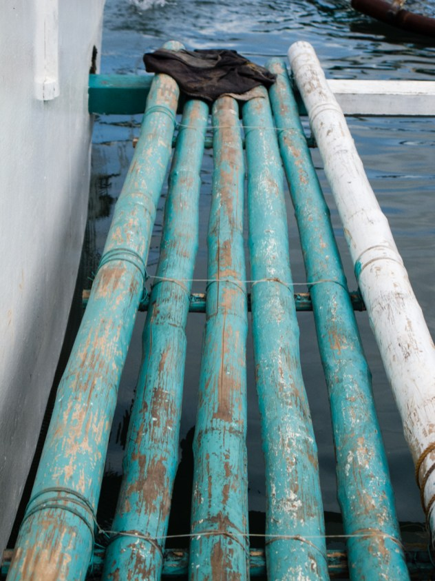 The walkway to the back of the boat was made of painted bamboo.