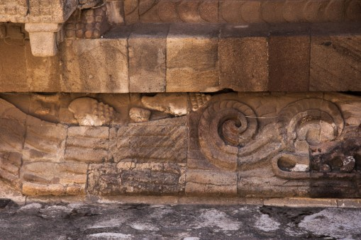 Bas-relief sculptures of the serpents' bodies run below the rows of heads. These also contain shells and other water symbolism, though there does not seem to be a consensus on what their significance is.
