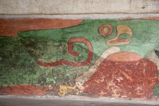 This is part of a long series of green birds along the base of an interior wall in the Palace of the Jaguars.