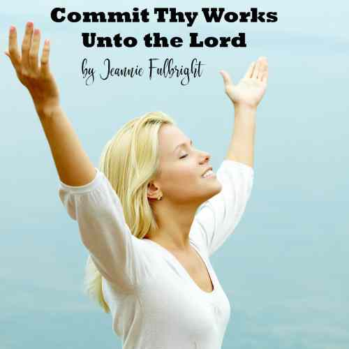 woman praising God with arms lifted