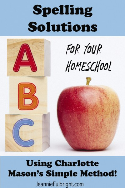 ABC Spelling toy blocks with apple on white background with copy