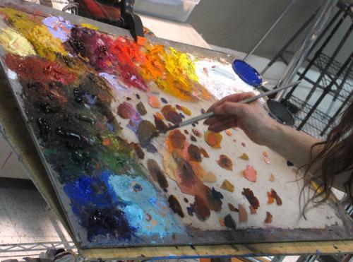 Rose Frantzen's palette arrangement on a tilted glass palette