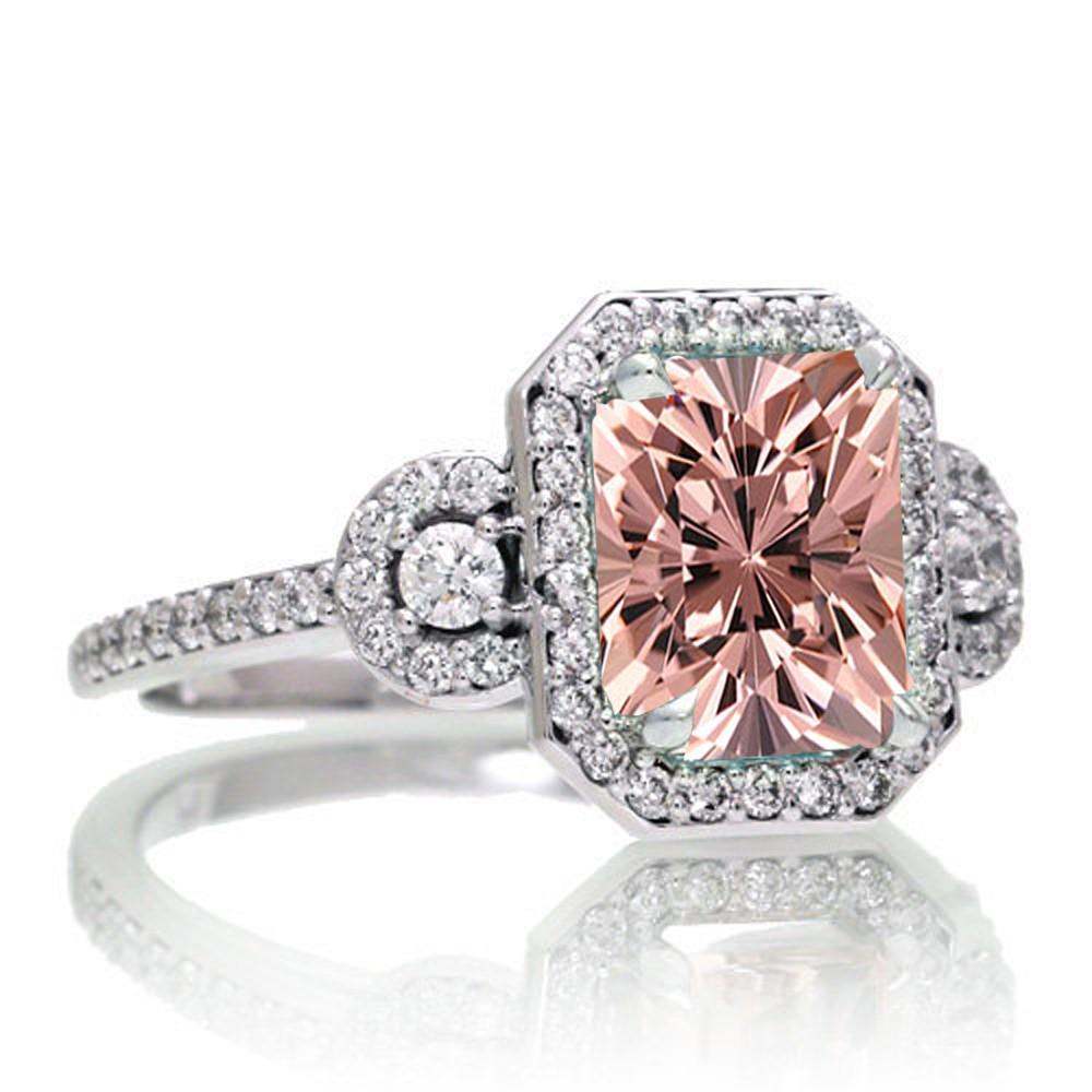 15 Carat Emerald Cut Three Stone Morganite Halo Diamond