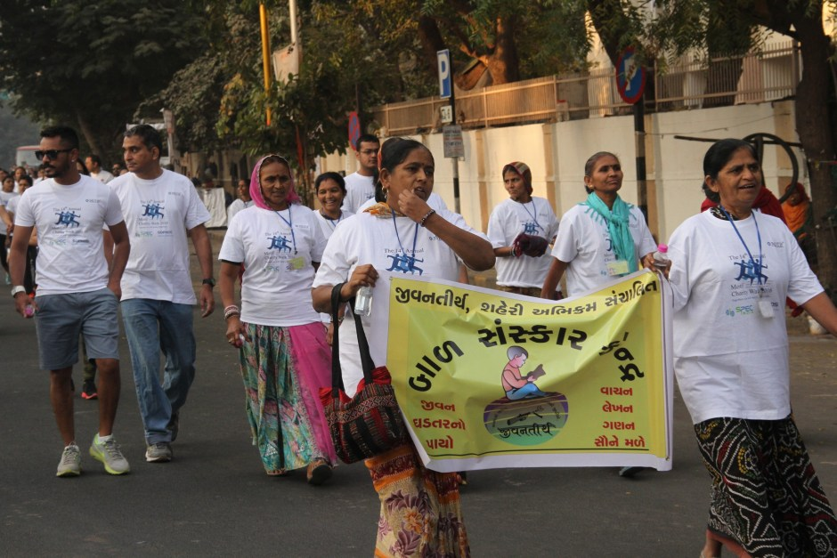 Women of Jeevantirth SHGs carrying BSK banners
