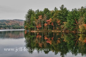 fall reflections of New England fall foliage on pond