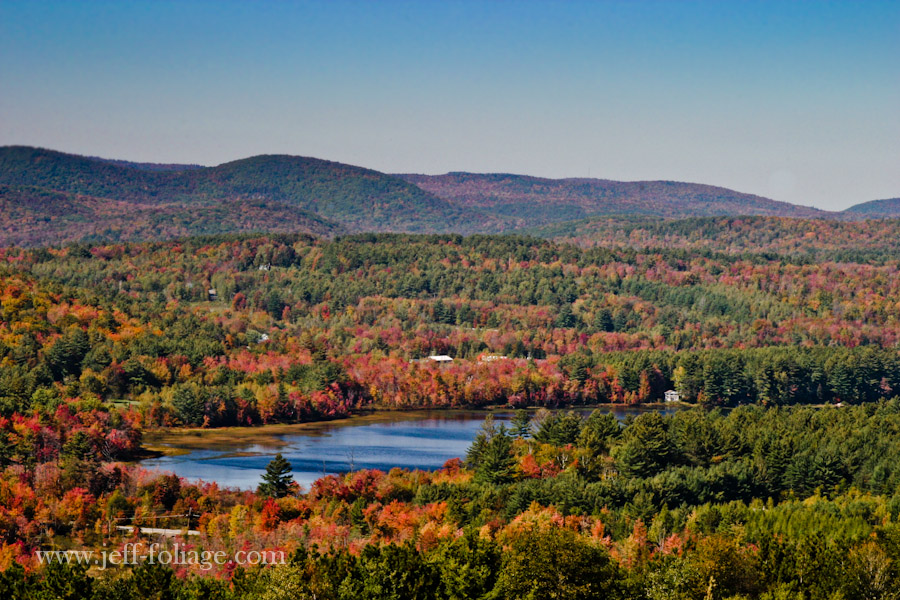 mixtures of pine trees and brightly colored Maples cover the surrounding hills with New England fall foliage